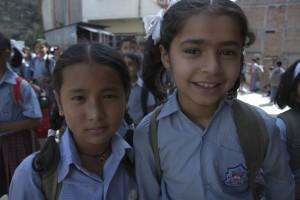 2 girls smiling outside_